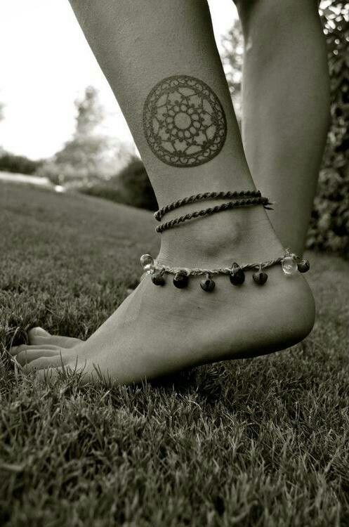 tat above her ankle, such an adorable swirly pattern..
