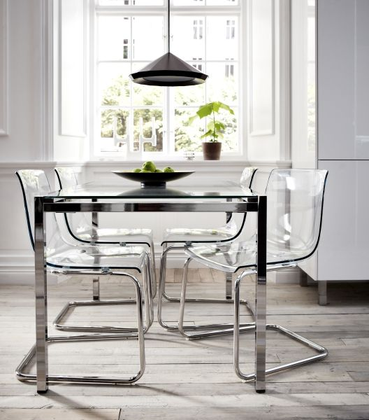 """I wanted to work with transparency as a predominate element in order to create furniture that gets its color and shape from the room it stands in. By combining glass and plastic with reflecting chrome, TOBIAS chair and TORSBY dining table become like an illusion, an abstract experience."" Designer: Carl Öjerstam"