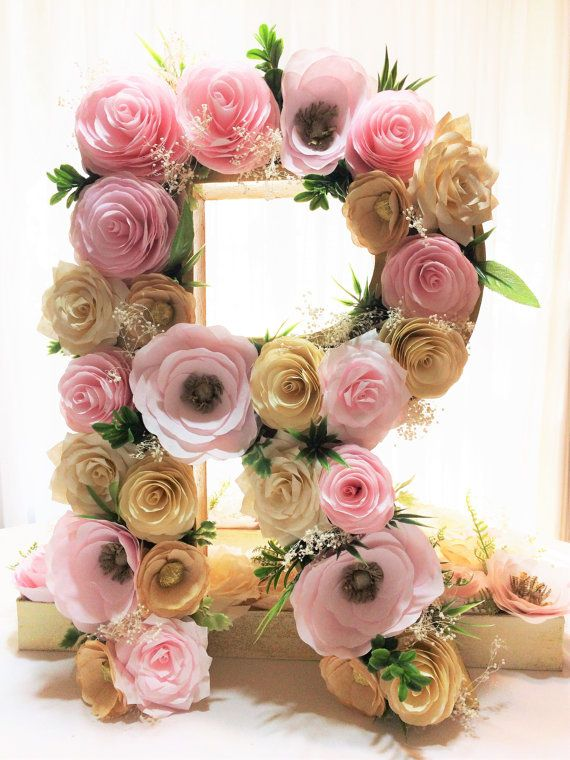 Floral letter filled with hand crafted paper flowers in blush, ivory and gold.