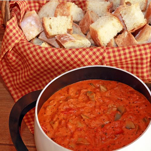 Easy Pizza Fondue, great for a kids sleep over, book club, bridge or poker game night. I have used toasted english muffins cut into wedges instead of french bread to remove the need of fondue forks.
