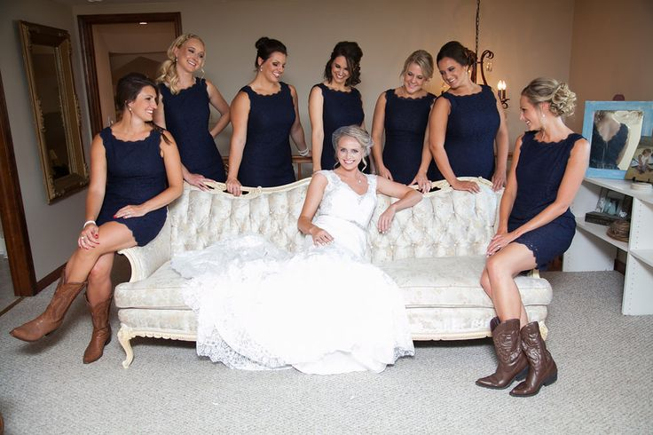 The bride and her bridesmaids in the farm bridal room. Cowboy boots. Navy blue bridesmaids dresses. Short bridesmaids dresses. Summer bridesmaids dress. Photo by Flybird Photography.