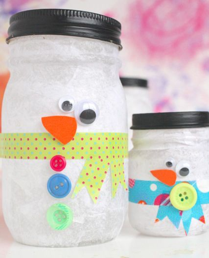 Cutie-cute snowman luminaries made from jars! Such a great decoration kids can make.