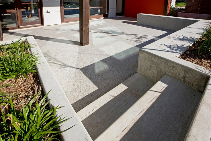 Outdoor polished concrete and concrete retaining wall