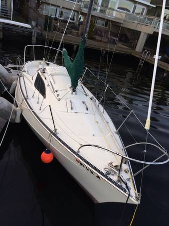 Kent Ranger 24, cabin.  $2000 w/out motor, +650 with motor.