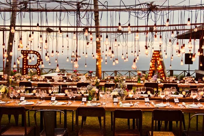 This mass of hanging lights is jaw-dropping at Ben & Angie's destination wedding in Bali. Decorations by Fred Lives Here. Photography by Studio Impressions.