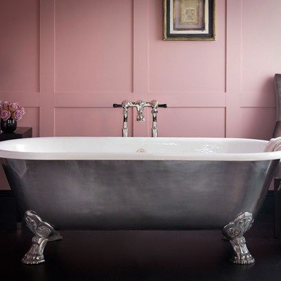 pink walls and roll top baths
