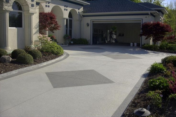 Such a welcoming sight! Learn more about concrete driveway resurfacing designs and costs, CALL (407) 423-3342 today!  Sun Surfaces of Orlando  330 Maguire Rd. Ocoee, Florida 34761 (407) 423-3342