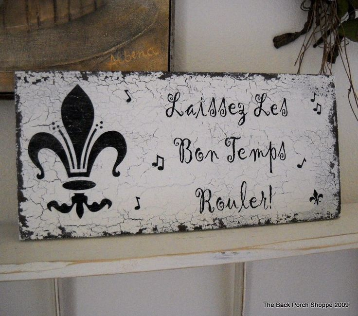 "fleur de leis, French, crackle paint, and ""let the good times roll""  PERFECT.  This will be in my kitchen."