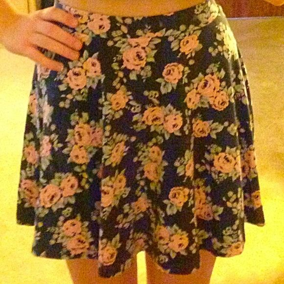 Black flower skirt An adorable circle skirt with muted tones of flowers. Perfect for any season because of the short length but dark colors. Only worn once! Outfit idea: wear with a black crop top and white canvas sneakers for a retro look. Divided Skirts Circle & Skater