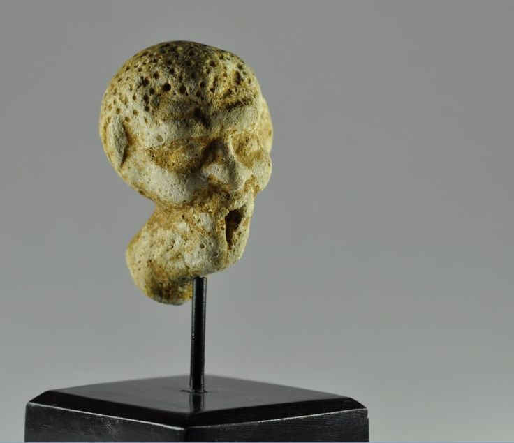 Greek grotesque head, 1st century B.C. Alexandrian greek grotesque head, alexandrian greek grotesque terracotta head, 6 cm high. Private collection