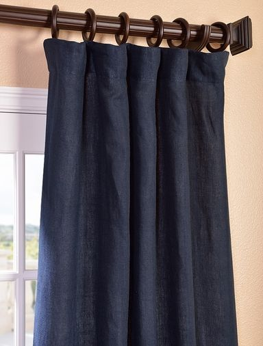 Denim Blue French Linen Curtain  Perfect way to ground the room so that the walls could be a pale yellow to bring in light and allow the dark wood of the floor to stand out.