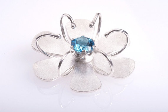 Silver Flower Pendant. Jolly Holiday Pendant with Topaz.