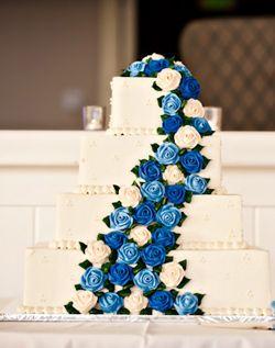 Square wedding cake with blue cascading roses