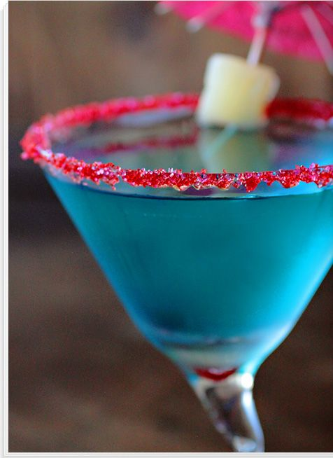 Blue Hawaiian - Rum, Blue Curacao, Pineapple Juice - Shake with Ice.  Serve in bright pink sugar rimmed frozen martini glass.