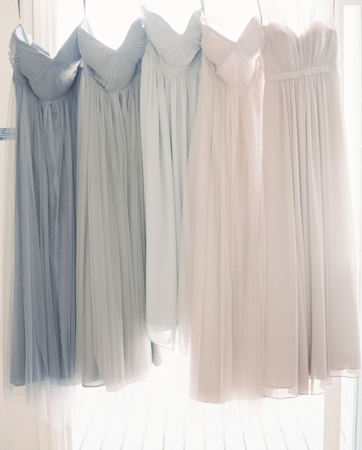 dusty grey taupe ombre bridesmaids dresses. The maid of honor with a gold belt | mix and match | Photography: Carmen Santorelli Photography - carmensantorellistudio.com Read More: http://www.stylemepretty.com/2015/05/15/dusty-blue-lavender-spring-garden-wedding/