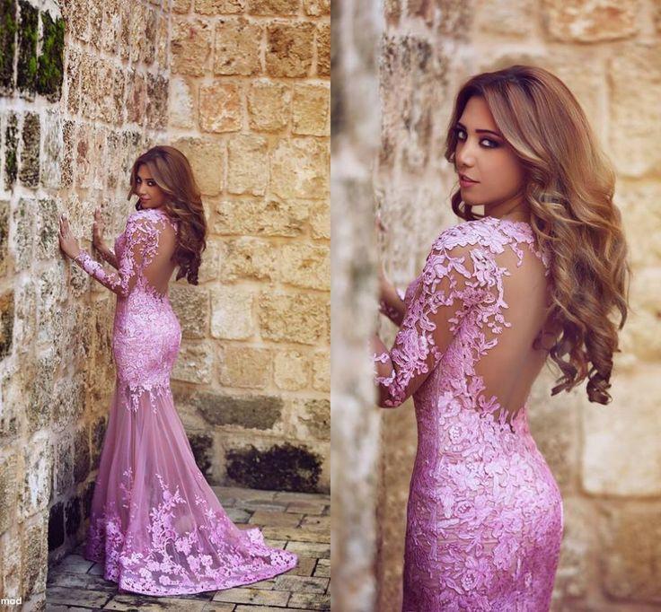Prachtige roze kanten jurk met open rug.
