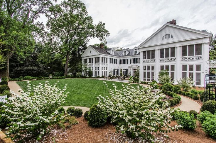 The screened-in porches on this Mansion were simply made for you and your morning coffee | Duke Mansion in Charlotte, North Carolina | Southern Living Handpicked Hotels