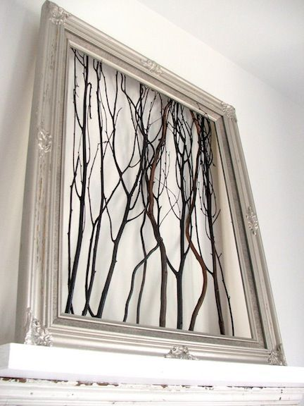 Revamp an old frame with spray paint, then adhere branches to the back with a staple gun. Prop on your mantle for the ultimate in natural home decor.