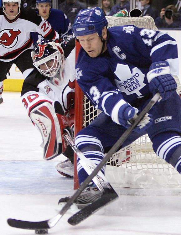 """Martin Brodeur tries to poke check Mats Sundin as the Toronto Maple Leafs host the New Jersey Devils, March 20, 2007."" -STEVE RUSSELL"
