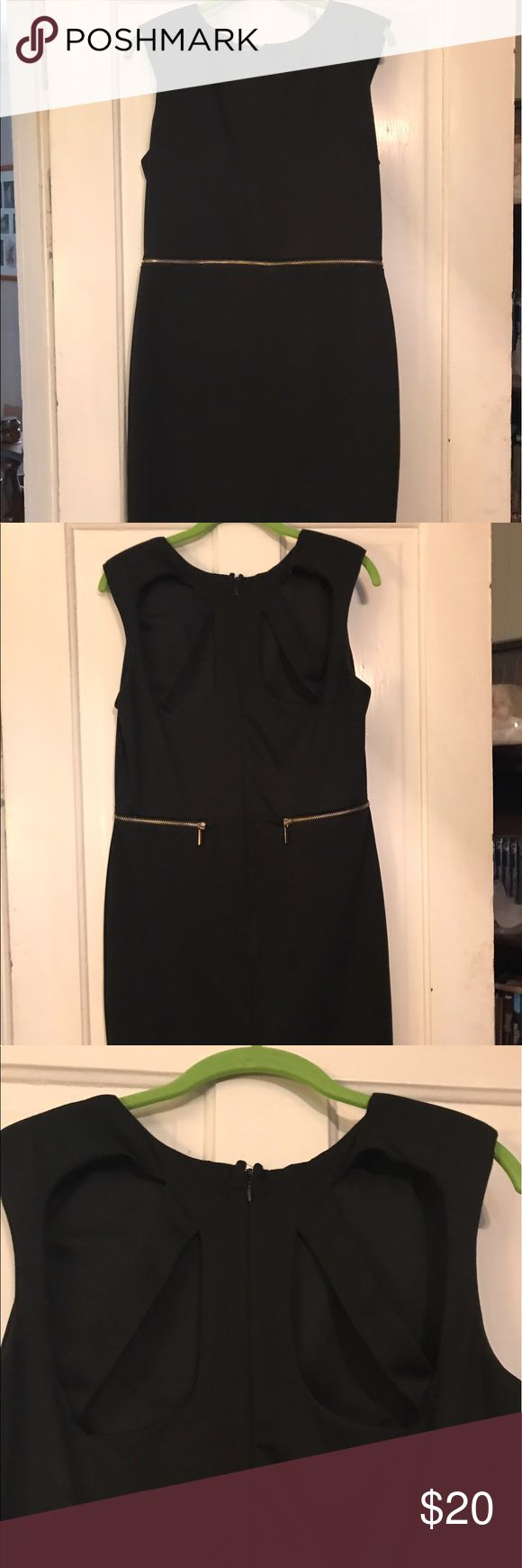 Kardashian Kollection Black Dress Black dress from the Kardashian Kollection at Sears. Has a zipper in the middle section that zips 85% of the way leaving the section in the back connected. cut outs on the top back of the dress. Size Large Kardashian Kollection Dresses