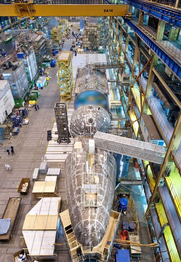 Production of the Royal Navy's Astute class of nuclear-powered submarine is in full swing in Barrow-in-Furness, Cumbria, with the first two of seven boats launched and two more taking shape. Have a look at the attack submarines, named Ambush, Artful and Audacious, being built by BAE Systems.