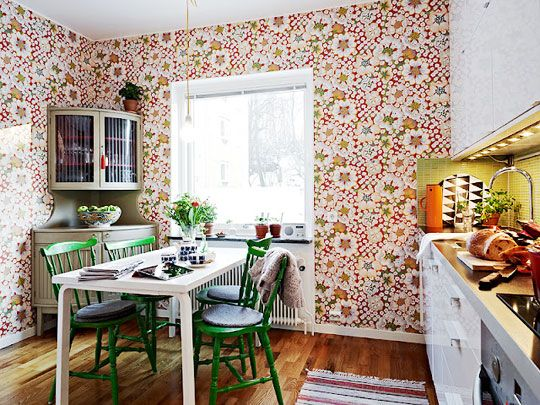 For some reason I love the wallpaper in the kitchen. I would probably never do it... but I still like the idea even though it is a bit much.