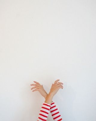 Minimalistic portrait of two white and red striped arms. Available at printler.com, the marketplace for photo art. Photographer Benny Byström