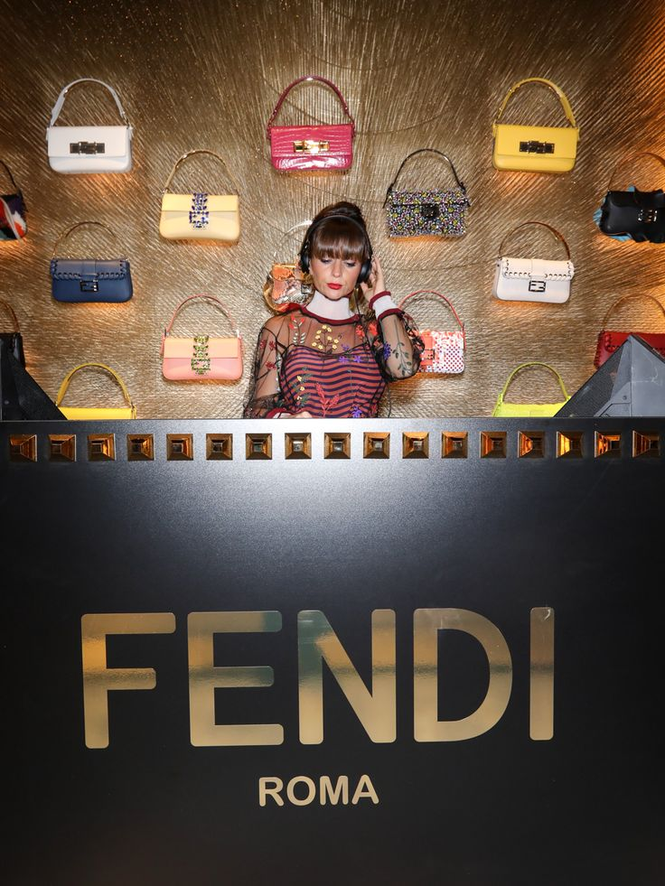 DJ Kriss at the Fendi Gold cocktail party in the Paris boutique.
