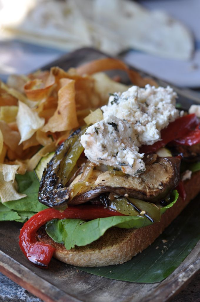 Grilled veggies on multigrain bread with black olive and garlic feta cheese at Kafe