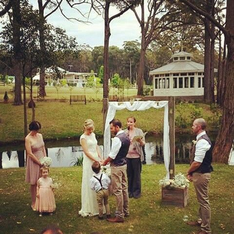 Rustic vintage wedding. Country setting. Wedding arbour with babys breath.