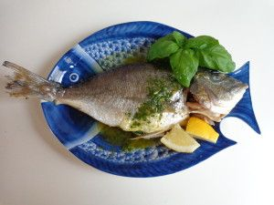 Baked porgy with French basil sauce The key to this recipe is to get the oven very hot before starting to cook the fish so that it will be crisp on the outside and melt-in-the-mouth tender on the i…