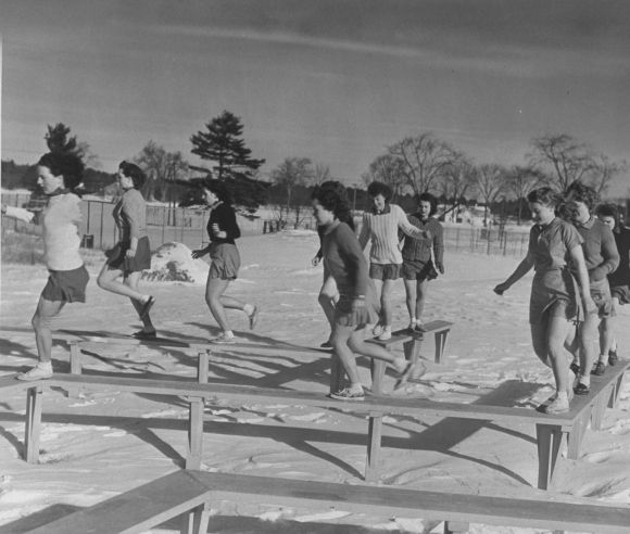 Coeds at the University of New Hampshire perform military drills in freezing weather, 1942
