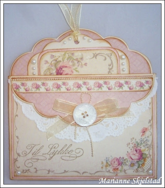Maybe my new gift card kit from Anna Griffin will work in a card like this. Love the pastels.