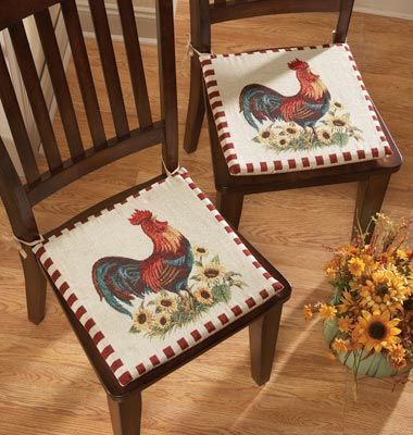 "Rooster Decor Chair Pad Cushions  In Our Catalog: 2PC Rooster Chair Cushions Availability: Backorder – Ships by 4/27/2012 Item #19073  $12.99 $9.99 You Save Up to 23%.  2pc Rooster Chair Cushions: Rooster cushions tie onto practically any chair; non-skid backing helps them stay in place.Cotton/polyester. Machine wash. Imported. 15""Square."