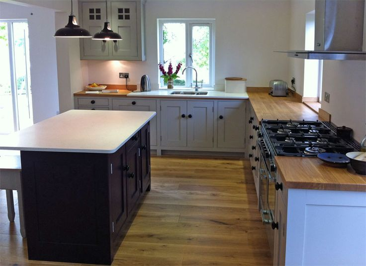 Hello lovely grey kitchen by Dunham Fitted Furniture with your inviting island made for drinking wine at whilst watching the cook! Hand made, hand painted, bespoke kitchens by www.dunhamfittedfurniture.co.uk