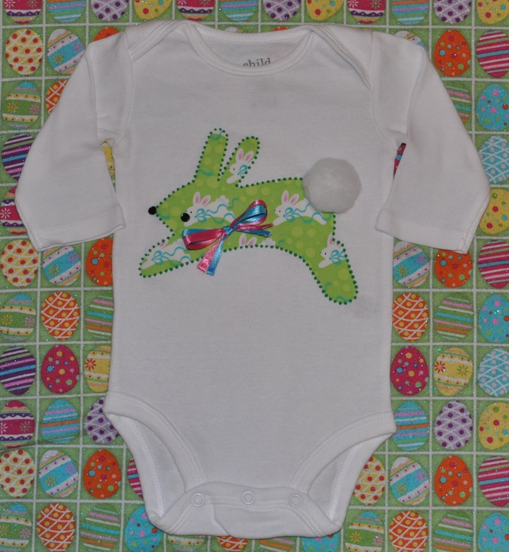 Baby Girl & Baby Boy Hopping Easter Bunny Rabbit Onesie, Colorful, With Bushy Pompom Tail, and Decorative Ribbon Bow, Short/Long Sleeve.   A large shape of a hopping bunny on fabric is bonded to the onesie, & outlined in green fabric paint.  Huge white pompom tail, black button eye, black pompom nose, & bow all firmly attached.  Available in many sizes.  Available in short sleeve and long sleeve.       https://www.etsy.com/listing/124971151/baby-girl-and-baby-boy-hopping-easter?ref=pr_shop