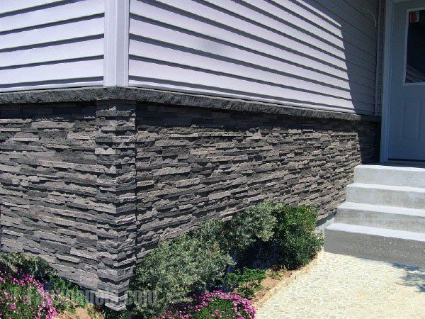 Mobile home foundation with the appearance of traditional stonework without the cost or weight of the real thing.
