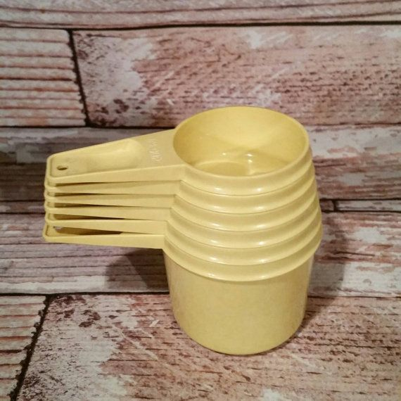 Check out this item in my Etsy shop https://www.etsy.com/listing/293024243/vintage-tupperware-measuring-cups-set-of
