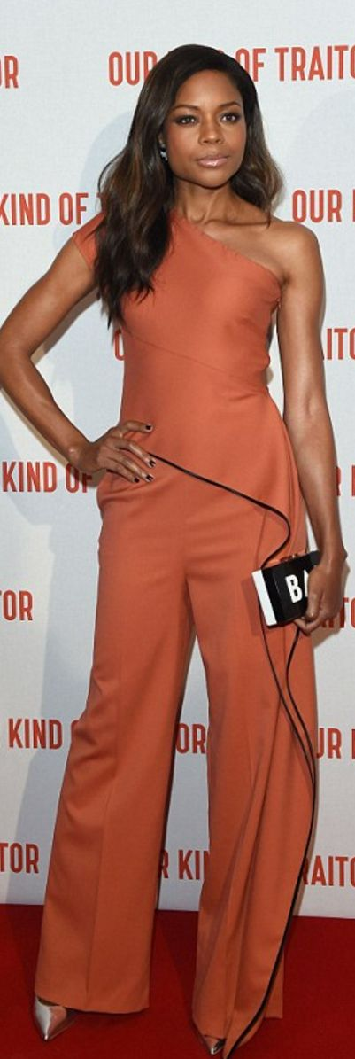 Who made Naomie Harris' orange one shoulder jumpsuit, silver pumps, clutch handbag, and jewelry?
