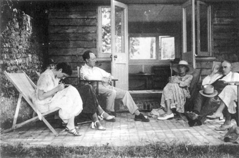 Virginia Woolf outside her summer house with Maynard Keynes, Angelica Bell, Vanessa Bell, and Clive Bell, 1930s.