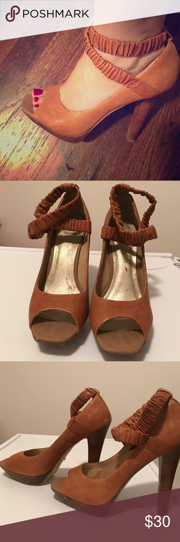Very high brown heels Light brown chunky heels, about 5 inches high with a small platform, with unique elastic ankle strap.  If you are used to high heels they are very comfy. Bakers Shoes Heels