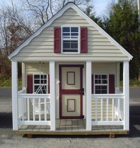 Playhouse with brown shutters and a porch