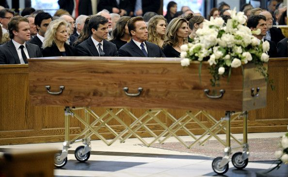 Shriver's son Mark Shriver, his daughter Maria Shriver, her husband actor and former California Governor Arnold Schwarzenegger, and Shriver's son Timothy Shriver sit near the casket during the funeral service for Sargent Shriver at Our Lady of Mercy Catholic Church January 22, 2011 in Potomac, Maryland. Robert Sargent Shriver Jr., a politician and activist who was the first leader of the Peace Corps and was involved in other social programs, died this week at the age of 95.