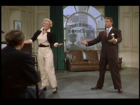 "Doris Day tap-dancing her way with Gene Nelson through George Gershwin's ""Somebody Loves Me.""  From 1951 film ""Lullaby of Broadway""."