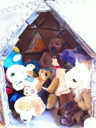 Insert stuffed animals, pillows, and kids