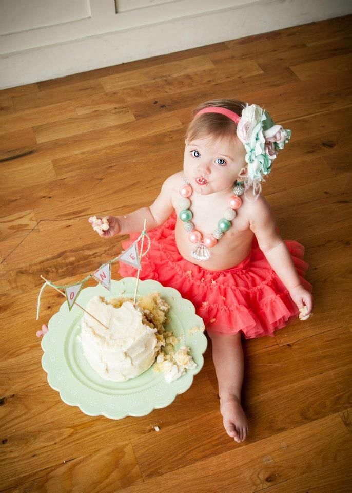 adorable idea for babys first birthday shoot, love the big necklace!