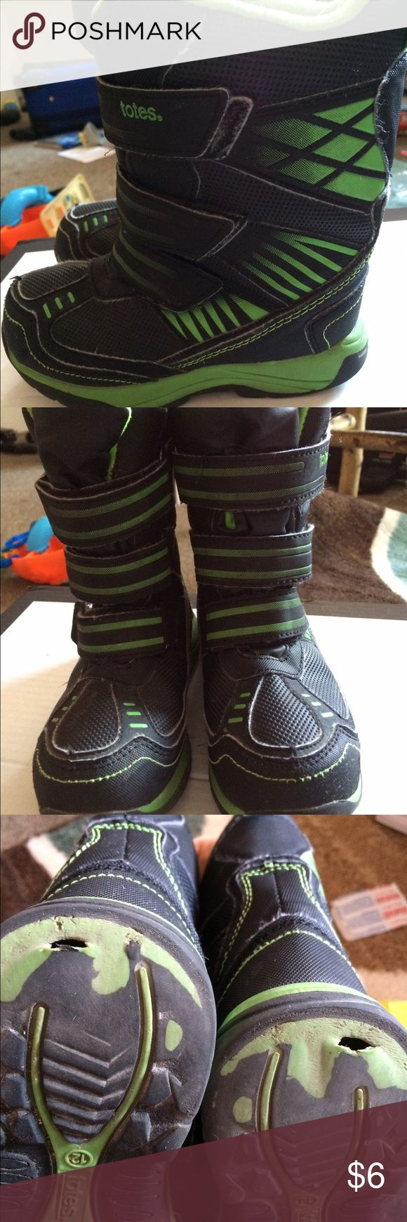 Toddler winter boots. Sturdy winter boots for active kid- lots of life left in them- superficial holes in the sole do not allow water to soak kids socks, do not hinder performance.  Some fuzzies in the Velcro. Shoes Boots