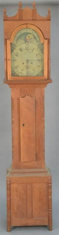 Cherry tall case clock having arched top over tombstone tiger maple door, all flanked by turned columns set on turned legs wi - Price Estimate: $1500 - $2500