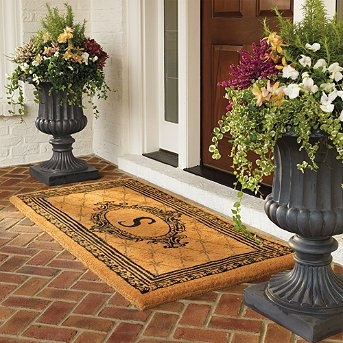 Large Tuscany Urns on porch stone