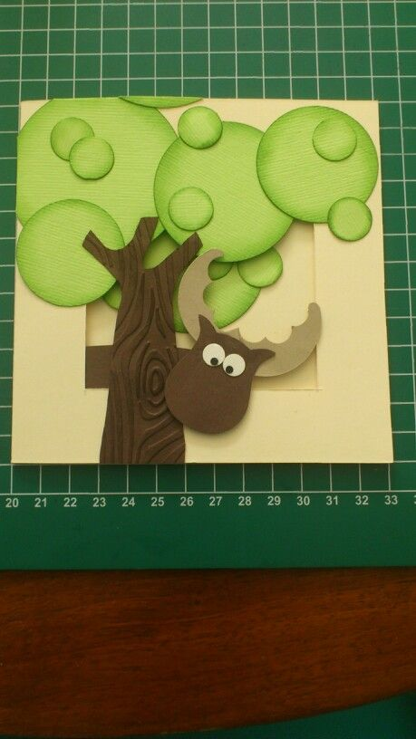 that's a Moose peeking from behind that tree!.... made with the owl punch